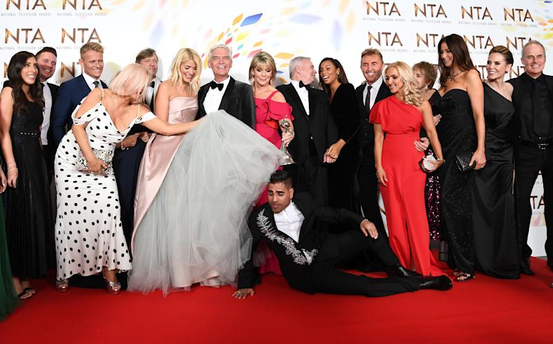 "LONDON, ENGLAND - JANUARY 28: Holly Willoughby, Phillip Schofield, Dr Ranj Singh, Ruth Langsford, Eamonn Holmes, Rochelle Humes, Lisa Snowdon and the cast of ""This Morning"", pose in the winners room after winning the Live Magazine Show award during the National Television Awards 2020 at The O2 Arena on January 28, 2020 in London, England. (Photo by Gareth Cattermole/Getty Images)"