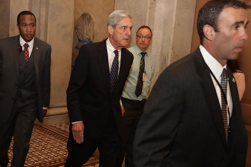Former FBI Director Robert Mueller is surrounded by security and staff as he leaves a meeting with senators at the U.S. Capitol June 21, 2017 in Washington, DC. Special Counsel overseeing the investigation into Russian interference in the 2016 presidential elections, Mueller was on Capitol Hill to meet with members of the Senate Judiciary Committee. (Photo: Chip Somodevilla/Getty Images)