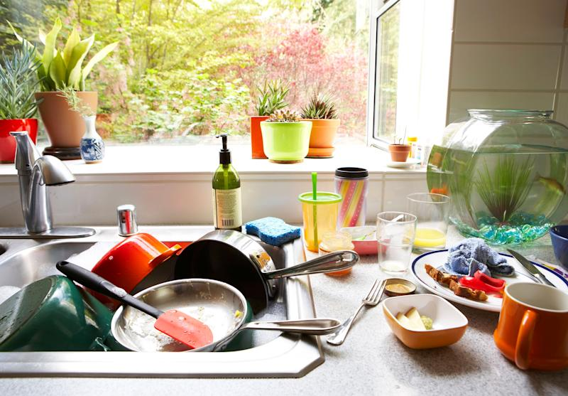 Food and socializing can make kitchen messiness especially bad.  (Photo: Thomas Northcut via Getty Images)