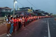 Protesters holding candles take part in a demonstration against the coup in a village near Dawei in southeast Myanmar