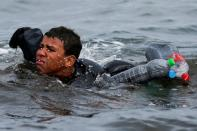 FILE PHOTO: Thousands of migrants cross the Spanish-Moroccan border