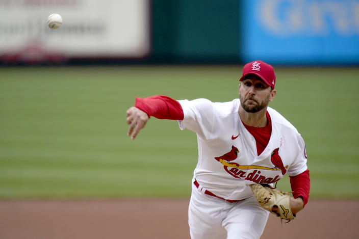St. Louis Cardinals starting pitcher Adam Wainwright throws during the first inning of a baseball game against the Colorado Rockies Sunday, May 9, 2021, in St. Louis. (AP Photo/Jeff Roberson)