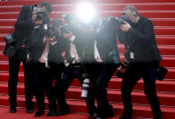Photographers take pictures on the red carpet at the premiere of the film 'Everything Went Fine' at the 74th international film festival, Cannes, southern France, Wednesday, July 7, 2021. (Photo by Vianney Le Caer/Invision/AP)
