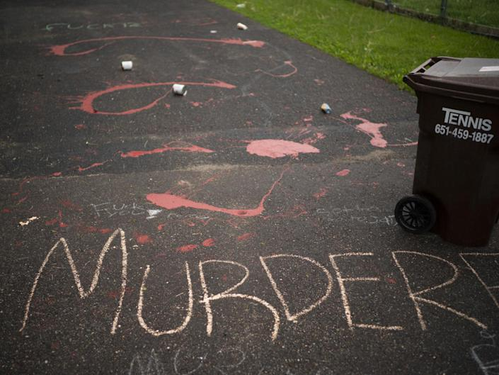 Splattered paint and chalk writing are on the driveway of the home of fired Minneapolis police Officer Derek Chauvin in Oakdale, Minn., Wednesday, May 27, 2020. The mayor of Minneapolis called Wednesday for criminal charges against Chauvin, the white police officer seen on video kneeling against the neck of Floyd George, a handcuffed black man who complained that he could not breathe and died in police custody. (Jeff Wheeler/Star Tribune via AP): Associated Press