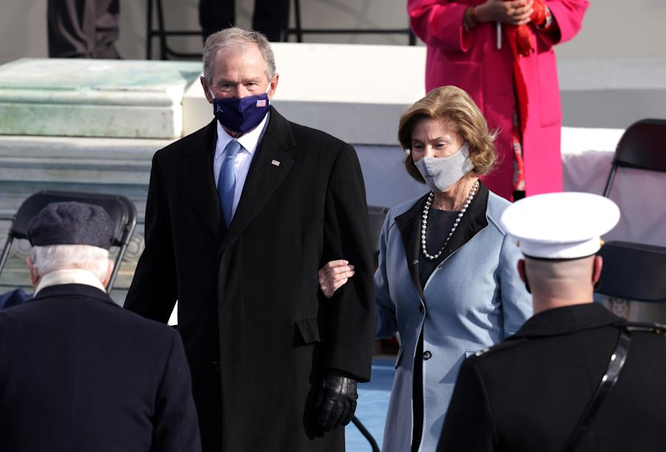 Former U.S. President George W. Bush and Laura Bush arrive to the inauguration of U.S. President-elect Joe Biden on the West Front of the U.S. Capitol on January 20, 2021 in Washington, DC. During today's inauguration ceremony Joe Biden becomes the 46th president of the United States. (Photo by Alex Wong/Getty Images)