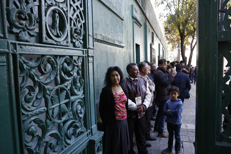 Gabriela Barrientos, 71, a retired secretary, is among the first to line up at the gate to enter the presidential residence know as Los Pinos, in Mexico City, Saturday, Dec. 1, 2018. In his first day as president, Andres Manuel Lopez Obrador threw open the gates of the luxurious official residence of presidents since the 1930s and plans to keep it open for the general public as a cultural attraction and as an extension of the Chapultepec park. (AP Photo/Ginnette Riquelme)
