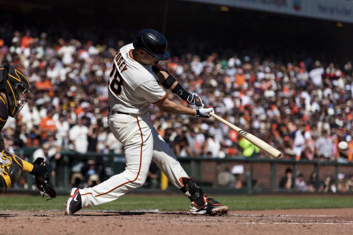 San Francisco Giants' Buster Posey hits a two-run single against the San Diego Padres in the fourth inning of a baseball game in San Francisco, Sunday, Oct. 3, 2021. (AP Photo/John Hefti)