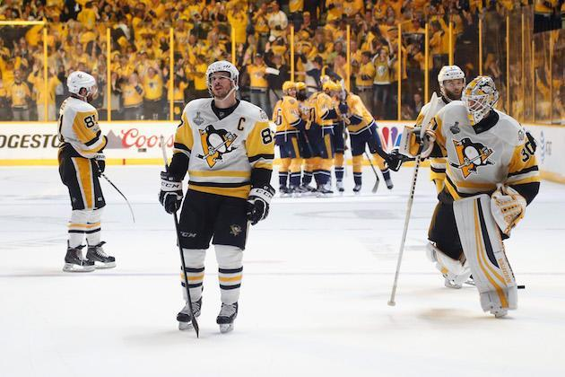 "NASHVILLE, TN – JUNE 05: <a class=""link rapid-noclick-resp"" href=""/nhl/players/3983/"" data-ylk=""slk:Phil Kessel"">Phil Kessel</a> #81, <a class=""link rapid-noclick-resp"" href=""/nhl/players/3737/"" data-ylk=""slk:Sidney Crosby"">Sidney Crosby</a> #87 and <a class=""link rapid-noclick-resp"" href=""/nhl/players/5774/"" data-ylk=""slk:Matt Murray"">Matt Murray</a> #30 of the <a class=""link rapid-noclick-resp"" href=""/nhl/teams/pit/"" data-ylk=""slk:Pittsburgh Penguins"">Pittsburgh Penguins</a> react as <a class=""link rapid-noclick-resp"" href=""/nhl/players/5691/"" data-ylk=""slk:Filip Forsberg"">Filip Forsberg</a> #9 of the <a class=""link rapid-noclick-resp"" href=""/nhl/teams/nas/"" data-ylk=""slk:Nashville Predators"">Nashville Predators</a> celebrates with his teammates after scoring an open net goal against the Pittsburgh Penguins during the third period in Game Four of the 2017 NHL Stanley Cup Final at the Bridgestone Arena on June 5, 2017 in Nashville, Tennessee. (Photo by Justin K. Aller/Getty Images)"