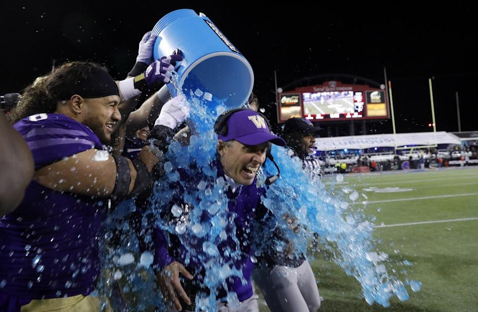 Washington head coach Chris Petersen is doused with a blue sports drink at the 2019 Las Vegas Bowl