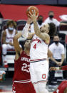 Ohio State guard Duane Washington, right, goes up for a shot over Indiana forward Trayce Jackson-Davis during the second half of an NCAA college basketball game in Columbus, Ohio, Saturday, Feb. 13, 2021. Ohio State won 78-59. (AP Photo/Paul Vernon)