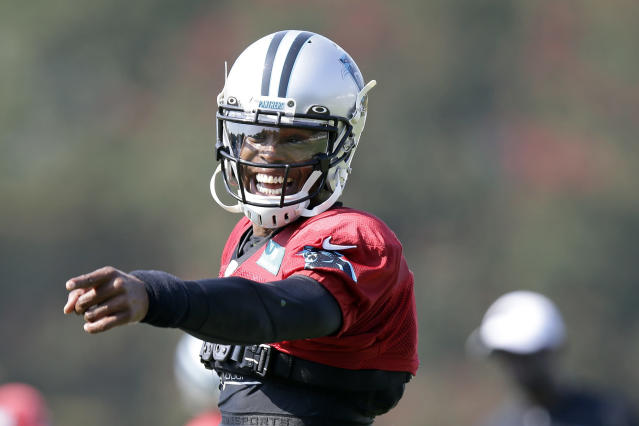 Carolina Panthers quarterback Cam Newton jokes with a player during an NFL football training camp with the Buffalo Bills in Spartanburg, S.C., Tuesday, Aug. 13, 2019. (AP Photo/Gerry Broome)
