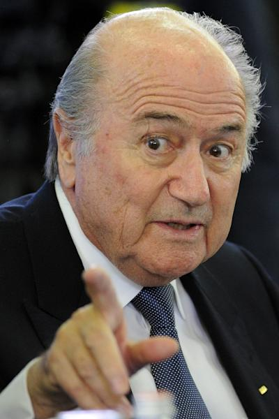 World football hit the headlines for all the wrong reasons in 2015, with the FIFA corruption scandal and its powerful president Sepp Blatter overshadowing any sporting fixture or achievement (AFP Photo/Kirill Kudryavtsev)