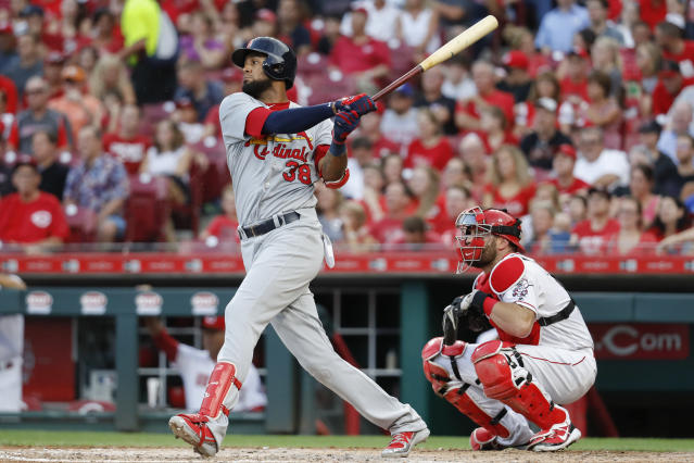 St. Louis Cardinals' Jose Martinez watches his RBI single off Cincinnati Reds starting pitcher Homer Bailey during the fourth inning of a baseball game, Tuesday, July 24, 2018, in Cincinnati. (AP Photo/John Minchillo)