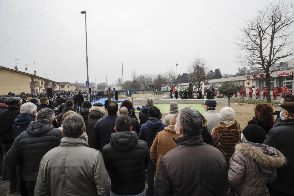Codogno's citizens attend the unveiling of a memorial for Covid deaths, in Codogno, northern Italy, Sunday, Feb. 21, 2021. The first case of locally spread COVID-19 in Europe was found in the small town of Codogno, Italy one year ago on February 21st, 2020. The next day the area became a red zone, locked down and cutoff from the rest of Italy with soldiers standing at roadblocks keeping anyone from entering of leaving. (AP Photo/Luca Bruno)
