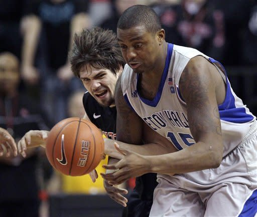 Rutgers' Gilvydas Biruta, left, of Lithuania, tries to steal the ball from Seton Hall's Herb Poipe (15) during the first half of an NCAA college basketball game in Piscataway, N.J., Wednesday, Feb. 8, 2012. (AP Photo/Mel Evans)
