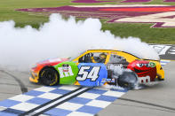 Kyle Busch does a burnout at the finish line after winning the NASCAR Xfinity Series auto race Saturday, June 19, 2021, in Lebanon, Tenn. (AP Photo/John Amis)