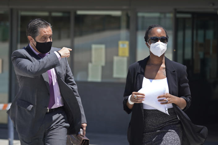 """Lawyer Javier Villalba, left and John McAfee's wife Janice leave the Brians 2 penitentiary center in Sant Esteve Sesrovires, near Barcelona, northeast Spain, Friday, June 25, 2021. A judge in northeastern Spain has ordered an autopsy for John McAfee, creator of the McAfee antivirus software, a gun-loving antivirus pioneer, cryptocurrency promoter and occasional politician who died in a cell pending extradition to the United States for allegedly evading millions in unpaid taxes. McAfee's Spanish lawyer, Javier Villalba, said the entrepreneur's death had come as a surprise to his wife and other relatives, since McAfee """"had not said goodbye."""" (AP Photo/Joan Mateu)"""