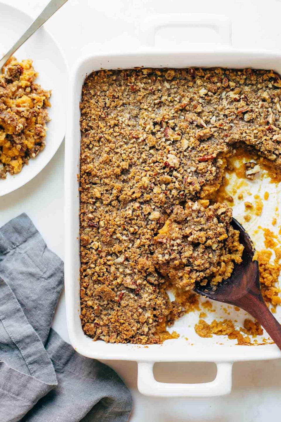 "<p>Keep it super simple, but still rich and delicious, with this mashed sweet potato casserole. The caramelized brown sugar and pecans on top give the soft vegetable underneath a full flavor that nicely complements the traditional turkey, gravy, and stuffings served on Thanksgiving. <br><br><a href="" http://pinchofyum.com/sweet-potato-casserole"" rel=""nofollow noopener"" target=""_blank"" data-ylk=""slk:Get the recipe"" class=""link rapid-noclick-resp"">Get the recipe</a> </p>"