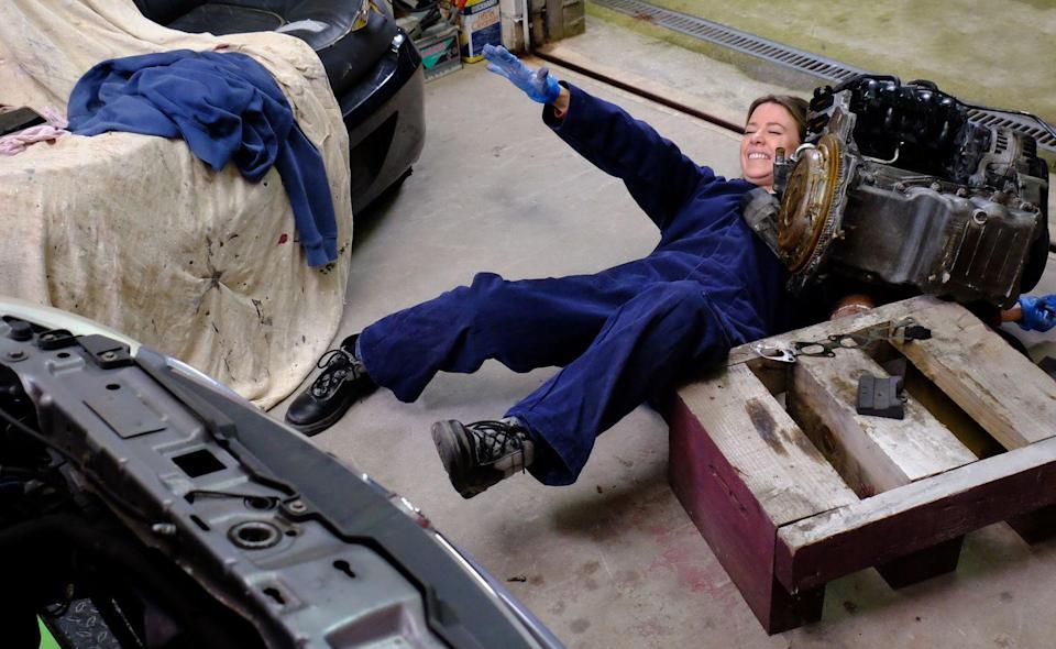 <p>As Abi works on a car, the engine slips, trapping her arm.</p>
