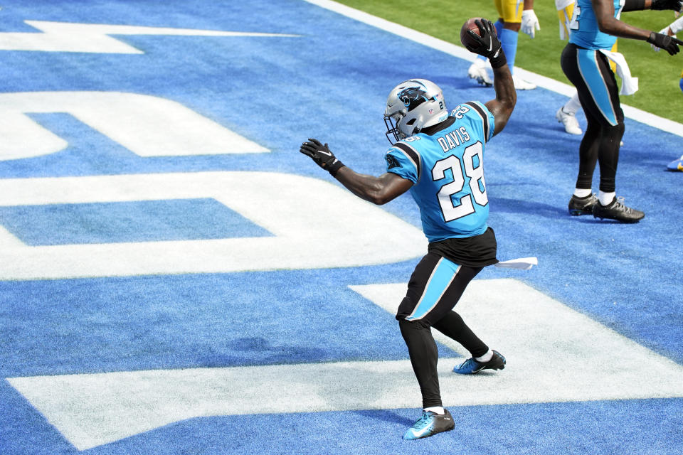 Carolina Panthers running back Mike Davis (28) celebrates after a touchdown catch against the Los Angeles Chargers during the first half of an NFL football game Sunday, Sept. 27, 2020, in Inglewood, Calif. (AP Photo/Ashley Landis )