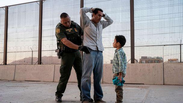 PHOTO: Jose, 27, with his son Jose Daniel, 6, is searched by US Customs and Border Protection Agent Frank Pino, May 16, 2019, in El Paso, Texas. (Paul Ratje/AFP/Getty Images, FILE)