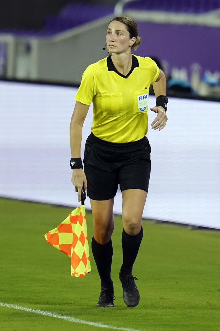 Assistant referee Kathryn Nesbitt runs the sideline as she watches play between Bermuda and Canada during the first half of a World Cup 2022 Group B qualifying soccer match, Thursday, March 25, 2021, in Orlando, Fla. Nesbitt, a 32-year-old from Philadelphia, had a breakthrough moment when she became the first woman to work as an on-field official for a World Cup qualifier in North and Central America and the Caribbean.(AP Photo/John Raoux)