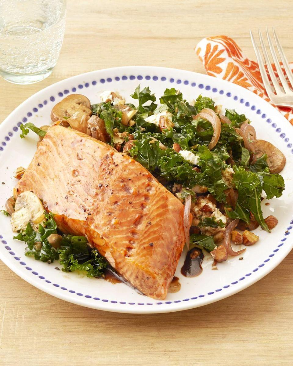 """<p>This is no boring kale salad. The greens are tossed with salty roasted almonds, crumbled goat cheese, and sautéed mushrooms, and the salmon gets a brush of balsamic glaze after it's finished baking.</p><p><strong><a href=""""https://www.thepioneerwoman.com/food-cooking/recipes/a32602657/kale-salad-with-salmon-recipe/"""" rel=""""nofollow noopener"""" target=""""_blank"""" data-ylk=""""slk:Get Ree's recipe."""" class=""""link rapid-noclick-resp"""">Get Ree's recipe.</a></strong> </p>"""