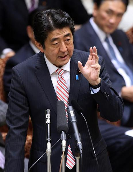 Japanese Prime Minister Shinzo Abe answers a question during the Upper House's audit committee session at the National Diet in Tokyo, on November 25, 2013