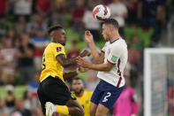 Jamaica's Jamal Lowe (9) and United States' Sergino Dest (2) leap for the ball during a FIFA World Cup qualifying soccer match, Thursday, Oct. 7, 2021, in Austin, Texas. (AP Photo/Eric Gay)