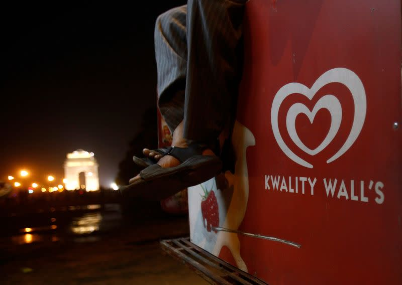 A vendor selling ice cream by Kwality Wall's, a Hindustan Unilever Limited brand, waits for customers in front of the India Gate in New Delhi