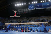 Guan Chenchen, of China, performs on the balance beam during the artistic gymnastics women's apparatus final at the 2020 Summer Olympics, Tuesday, Aug. 3, 2021, in Tokyo, Japan. (AP Photo/Gregory Bull)