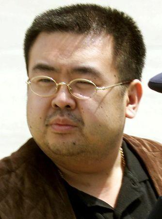 FILE PHOTO: North Korean heir-apparent Kim Jong Nam takes a look around as he boards a plane upon his deportation from Japan at Tokyo's Narita international airport May 4, 2001.   REUTERS/Eriko Sugita/File Photo