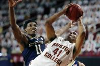 Boston College's Steffon Mitchell (41) tries to get a shot off against Notre Dame's Juwan Durham (11) during the second half of an NCAA college basketball game, Saturday, Feb. 27, 2021, in Boston. (AP Photo/Michael Dwyer)
