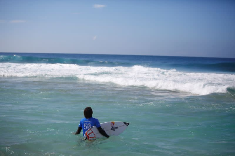 FILE PHOTO: Surfer Kanoa Igarashi prepares for his heat at the Billabong Pipe Masters at the Banzai Pipeline in Pupukea on the island of Oahu
