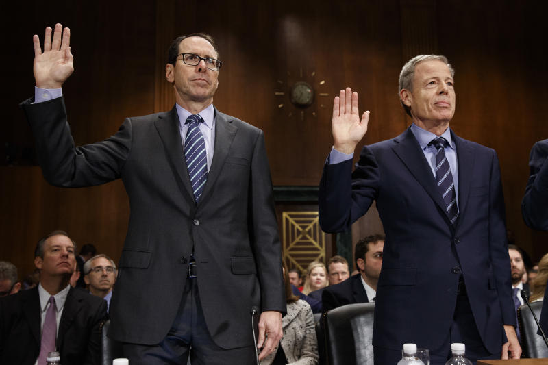 FILE - In this Wednesday, Dec. 7, 2016, file photo, AT&T Chairman and CEO Randall Stephenson, left, and Time Warner Chairman and CEO Jeffrey Bewkes are sworn in on Capitol Hill in Washington, prior to testifying before a Senate Judiciary subcommittee hearing on the proposed merger between AT&T and Time Warner. The Justice Department intends to sue AT&T to stop its $85 billion purchase of Time Warner, according to a person familiar with the matter who was not authorized to discuss the matter ahead of the suit's official filing. (AP Photo/Evan Vucci, File)