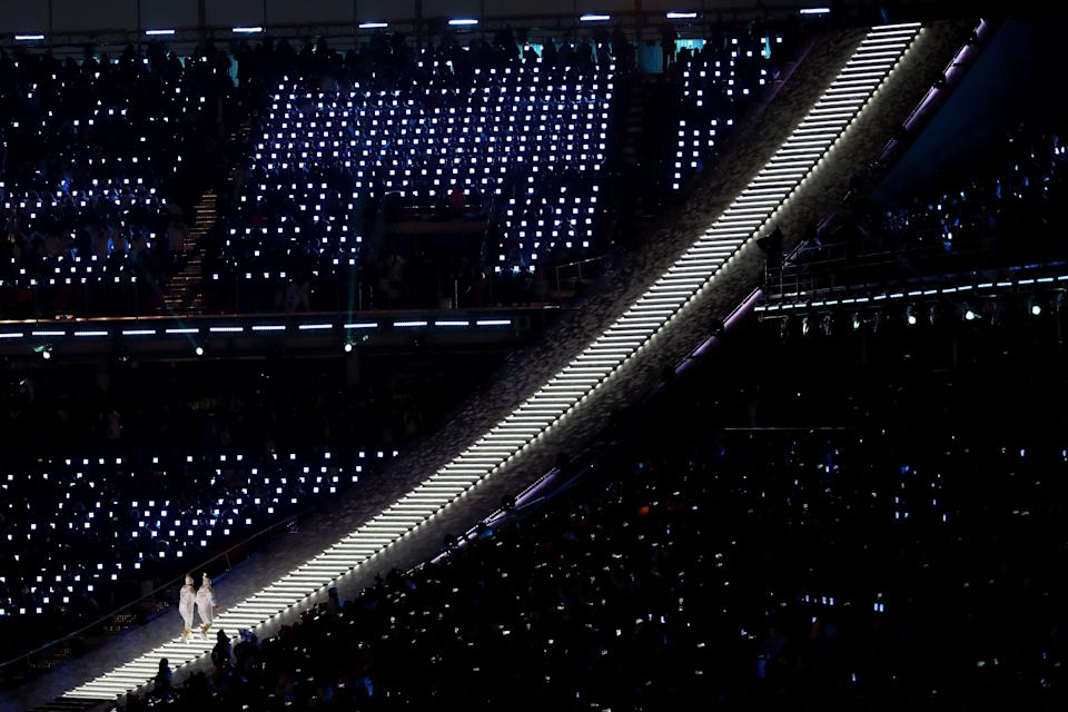 <p>The Olympic torch is carried to the cauldron during the Opening Ceremony of the PyeongChang 2018 Winter Olympic Games at PyeongChang Olympic Stadium on February 9, 2018 in Pyeongchang-gun, South Korea. (Photo by Ronald Martinez/Getty Images) </p>