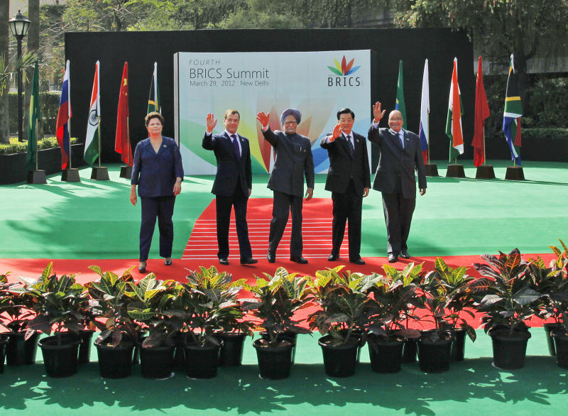 From left to right, Brazil's President Dilma Rousseff, Russian President Dmitry Medvedev, Indian Prime Minister Manmohan Singh, Chinese President Hu Jintao and South African President Jacob Zuma walk away together following the group picture for the BRICS 2012 Summit in New Delhi, India, Thursday, March 29, 2012. Heads of States of the five nations are meeting in the Indian capital Thursday. (AP Photo/Saurabh Das)