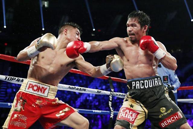 Manny Pacquiao (R) throws a punch at Jessie Vargas during their fight Saturday. (AP)