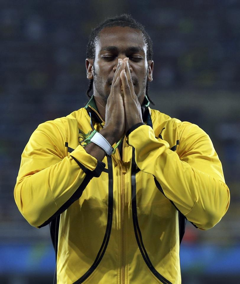 2016 Rio Olympics - Athletics - Victory Ceremony - Men's 4 x 100m Relay Victory Ceremony - Olympic Stadium - Rio de Janeiro, Brazil - 20/08/2016. Yohan Blake (JAM) of Jamaica reacts during the medal ceremony.   REUTERS/Stoyan Nenov  FOR EDITORIAL USE ONLY. NOT FOR SALE FOR MARKETING OR ADVERTISING CAMPAIGNS.
