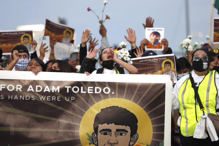 Demonstrators in Chicago attend a peace walk honoring the life of police-shooting victim 13-year-old Adam Toledo. (Shafkat Anowar/AP)