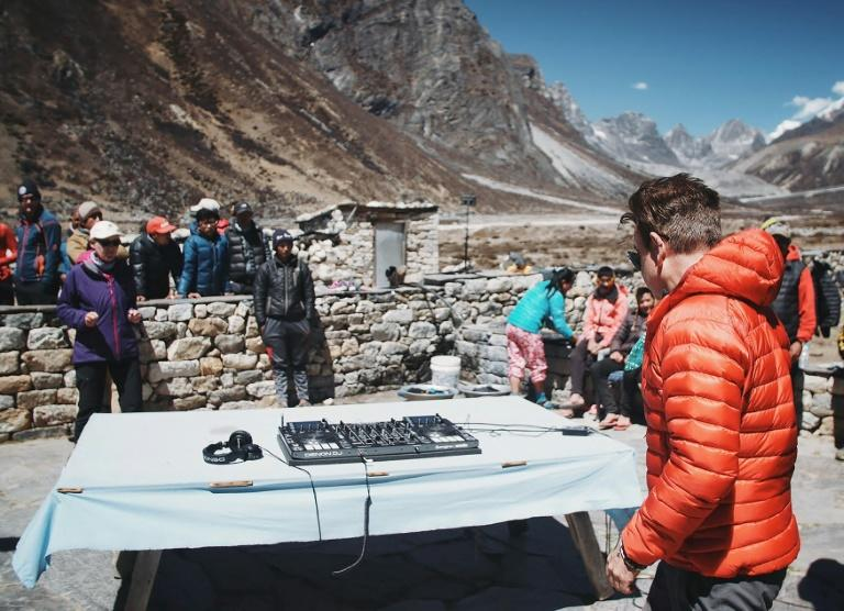 """Influential British DJ Paul Oakenfold has reached Mount Everest's base camp where he plans to host the """"highest party on earth"""", performing a set at 5,380 metres (17,600 feet)"""