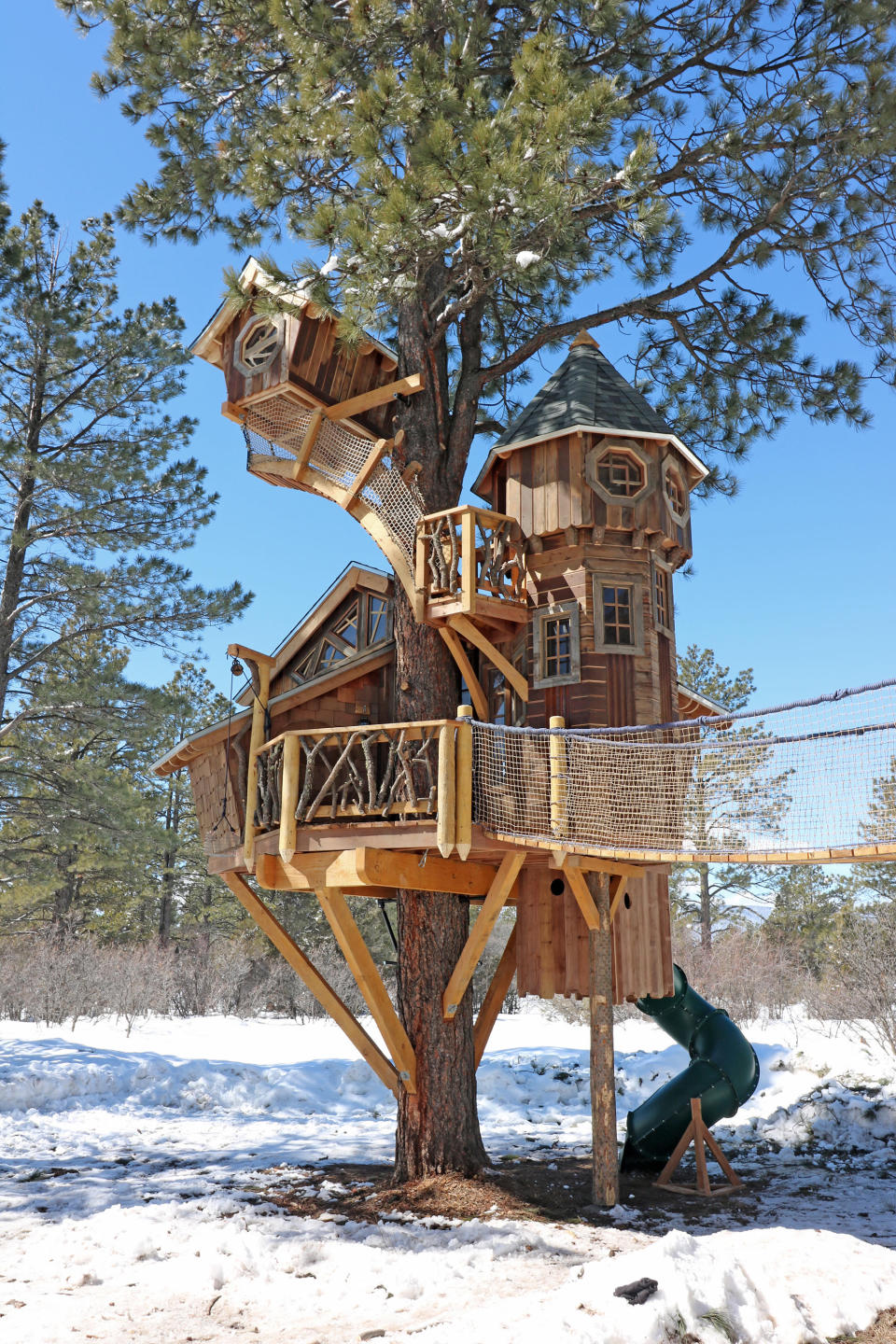 This undated photo provided by Aaron Smith, who owns Treecraft Design-Built in Fort Collins, Colorado, shows a Pagosa Springs treehouse Smith and his firm built. Smith said interest in treehouses has increased in the last few years. (Aaron Smith via AP)
