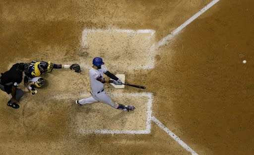 Texas Rangers' Nomar Mazara hits a single during the ninth inning of a baseball game against the Milwaukee Brewers Saturday, Aug. 10, 2019, in Milwaukee. (AP Photo/Morry Gash)