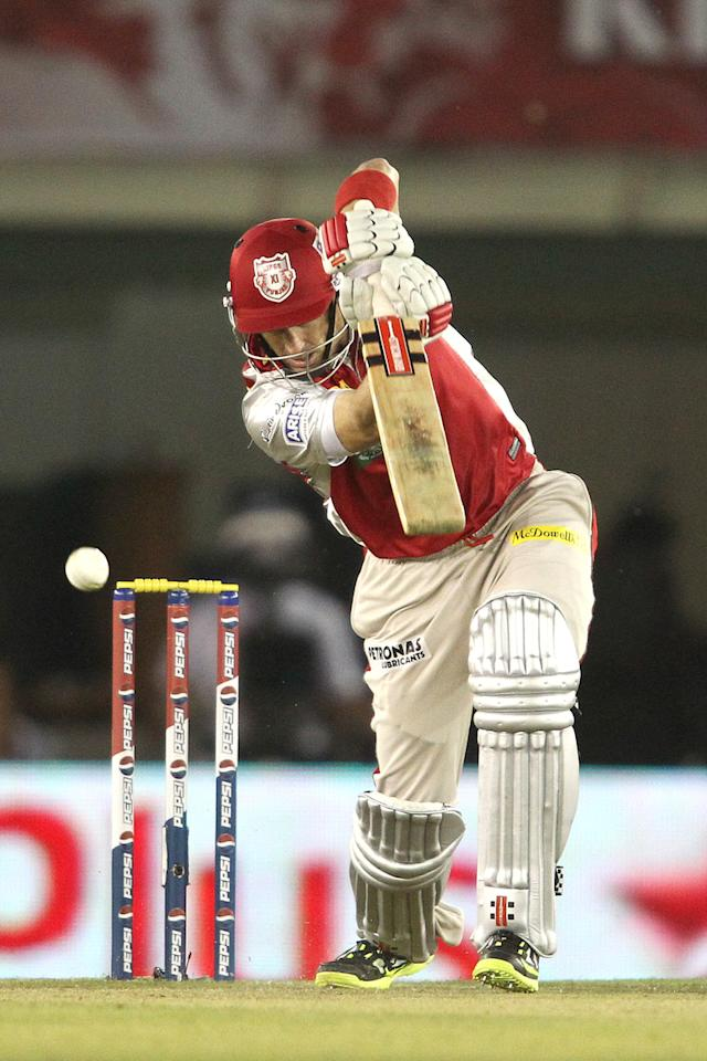 David Hussey of Kings XI Punjab drives a delivery during match 11 of of the Pepsi Indian Premier League between The Kings XI Punjab and the Chennai Superkings held at the PCA Stadium, Mohal, India  on the 10th April 2013..Photo by Shaun Roy-IPL-SPORTZPICS  ..Use of this image is subject to the terms and conditions as outlined by the BCCI. These terms can be found by following this link:..https://ec.yimg.com/ec?url=http%3a%2f%2fwww.sportzpics.co.za%2fimage%2fI0000SoRagM2cIEc&t=1490414229&sig=1h3DtZT01gYyayqPeG9hNA--~C