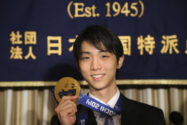 Sochi Winter Olympics men's figure skating gold medalist Yuzuru Hanyu shows his gold medal during a press conference at the Foreign Correspondents' Club of Japan in Tokyo Thursday, April 24, 2014. After winning just about everything there was to win in 2014, Japanese skater Hanyu says there is still room for improvement as he prepares for another season. (AP Photo/Koji Sasahara)