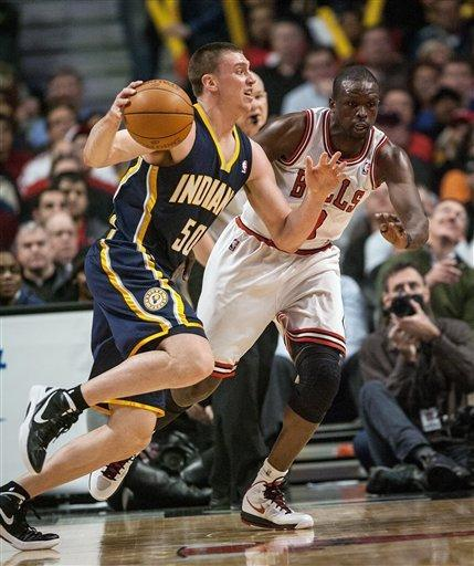Indiana Pacers' Tyler Hansbrough drives sd Chicago Bulls' Luol Deng defends during the first quarter of an NBA basketball game in Chicago on Monday, March 5, 2012. (AP Photo/Charles Cherney)
