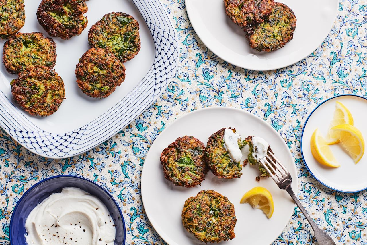 """These golden brown fritters, which come from Shvil's Tunisian-Jewish family, are bursting with fresh flavor, thanks to a generous helping of Swiss chard, parsley, cilantro, and dill. They're especially delicious as part of the traditional Sephardic Rosh Hashanah seder meal. <a href=""""https://www.epicurious.com/recipes/food/views/swiss-chard-and-herb-fritters?mbid=synd_yahoo_rss"""">See recipe.</a>"""