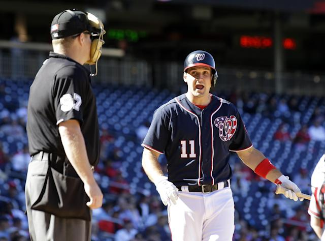 Washington Nationals' Ryan Zimmerman is not happy with a called strike by home plate umpire Todd Tichenor during the eighth inning of the first baseball game of a doubleheader against the Atlanta Braves at Nationals Park Tuesday, Sept. 17, 2013, in Washington. The Nationals won 6-5. (AP Photo/Alex Brandon)
