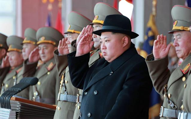 Kim Jong-unattending a military parade to mark the 70th anniversary of the Korean People's Army - AFP