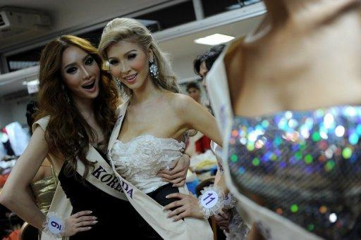 Canada's Jenna Talackova (centre) poses ahead of a 2010 beauty pageant in Thailand. With blond locks, long legs and delicate features, Talackova would have been a strong competitor in Canada's Miss Universe pageant but was disqualified, she says, because she used to be male